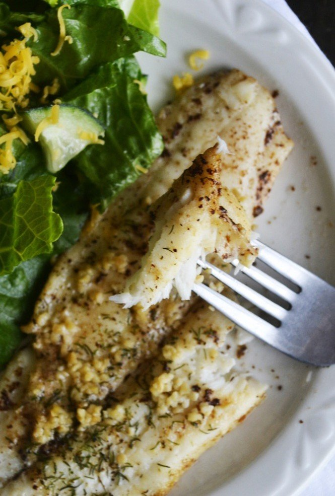 What is the perfect baked flounder recipe? Aromatic garlic, mild dill, and sweet browned butter. Yep -- perfect, tasty, AND easy.