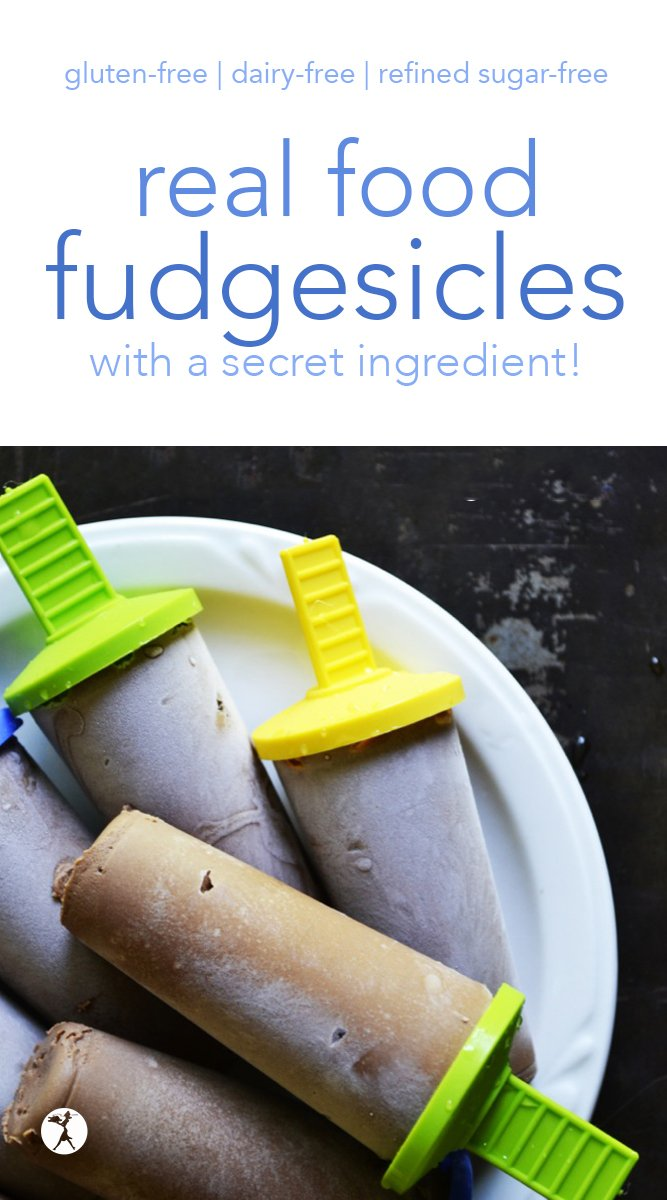 These real food fudgesicles are sure to become a favorite snack! With only a few natural ingredients (including a secret one!) moms won't mind feeding this treat to their kids. #realfood #glutenfree #dairyfree #refinedsugarfree #fudgesicles #snacks #chocolate