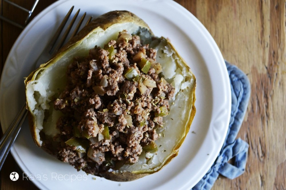 sloppy joe backed potato on a white plate with a fork to the right for easy whole30 recipes