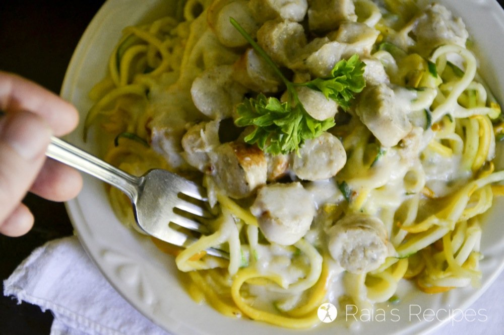 Enjoy pasta again with these grain-free Summer Squash Zoodles with Chicken Sausage Alfredo Sauce! RaiasRecipes.com