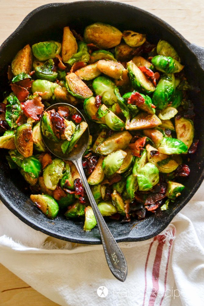 Delicious pan-fried Brussels sprouts with bacon and dried cranberries from raiasrecipes.com