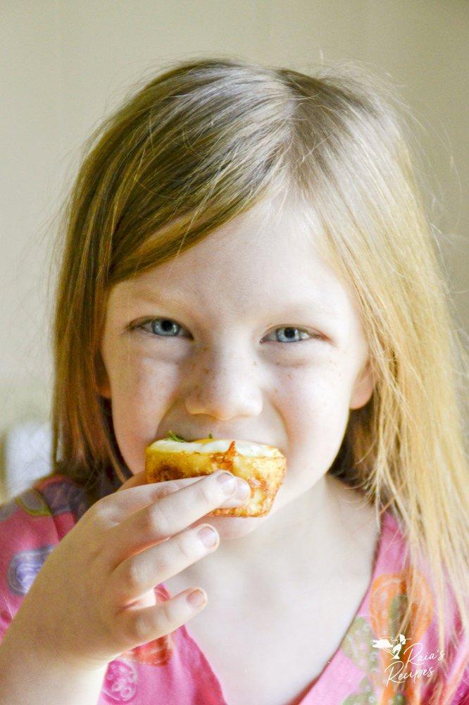 biting an egg & potato breakfast muffin