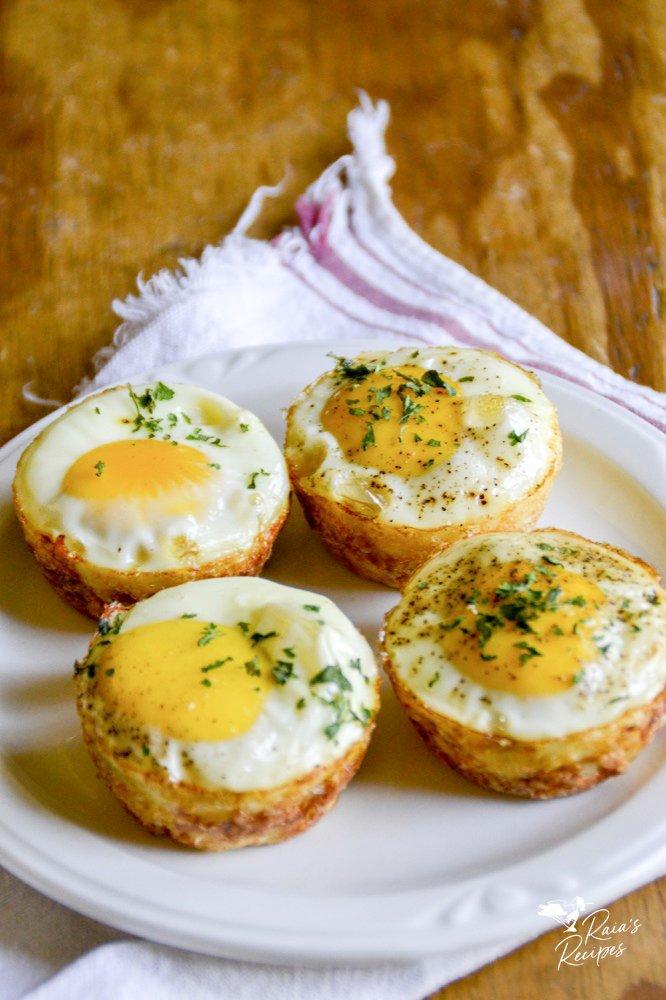 a plate of egg & potato breakfast muffins