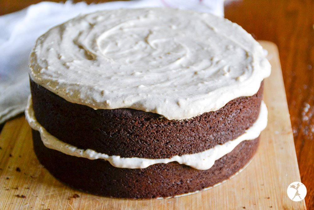 Uncut grain-free Mexican chocolate cake with cinnamon cream cheese frosting. raiasrecipes.com