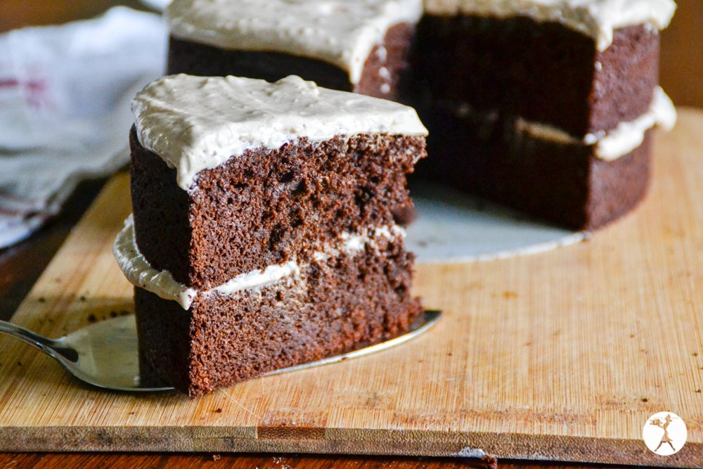 A slice of grain-free Mexican chocolate cake with cinnamon cream cheese frosting. raiasrecipes.com