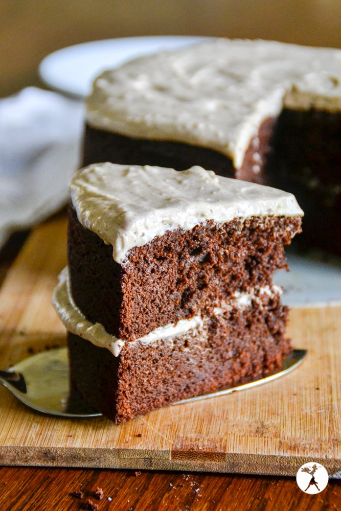 A slice of delicious grain-free Mexican chocolate cake with cinnamon cream cheese frosting. raiasrecipes.com