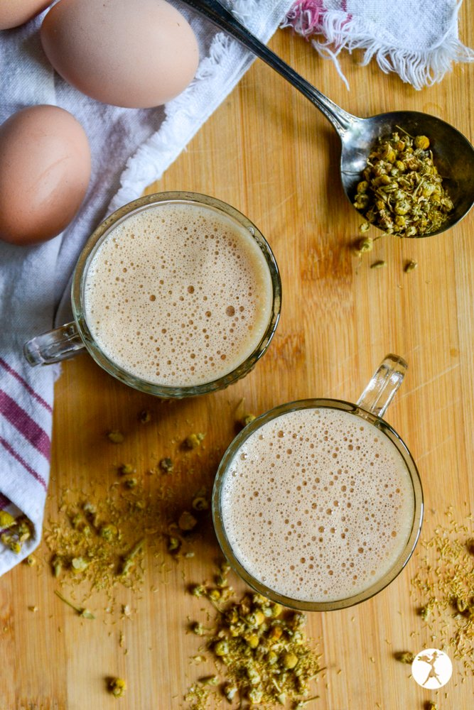 Two glass mugs of chocolate chamomile moon milk from raiasrecipes.com