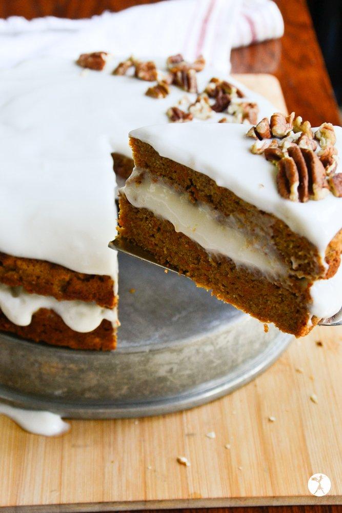 A piece of easy paleo carrot cake from raiasrecipes.com