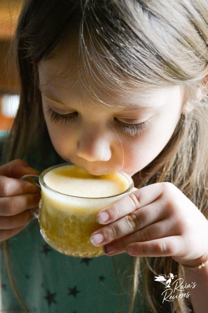 little one drinking paleo pumpkin eggnog from raiasrecipes.com